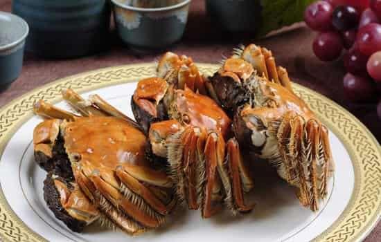 螃蟹吃多了会中毒吗
